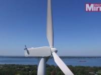 mysterious-man-on-wind-turbine01