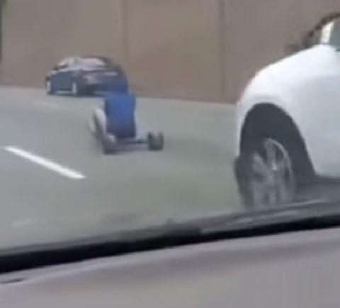 man-rides-big-wheel-on-interstate02